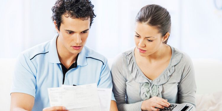 Couple checking utility bills